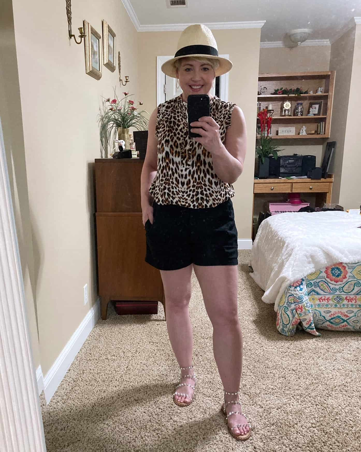 shorts outfit with leopard top and straw hat