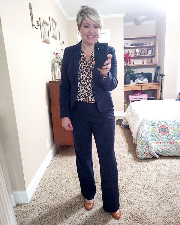 leopard top with navy suit