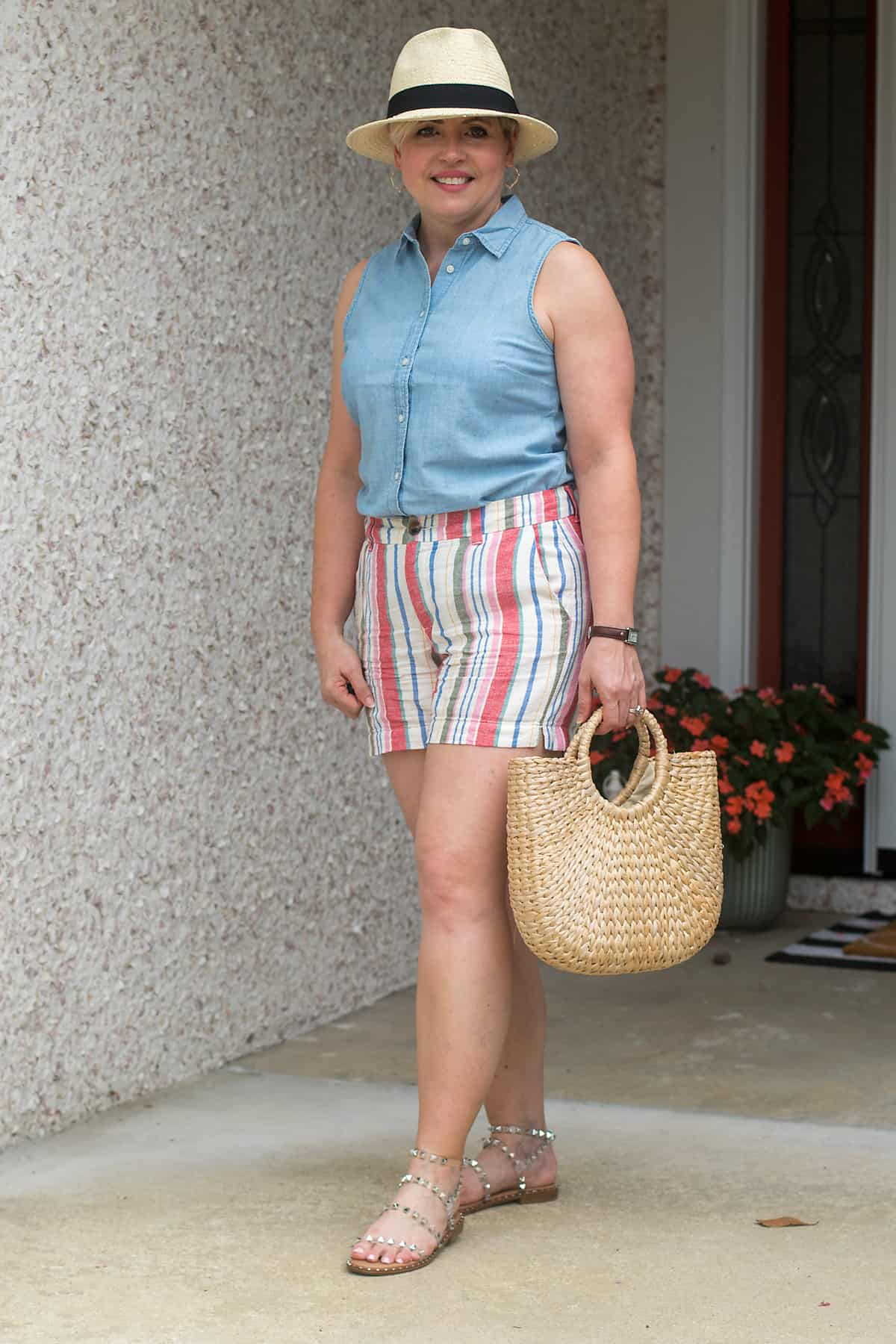 womens cute summer outfit with striped linen shorts