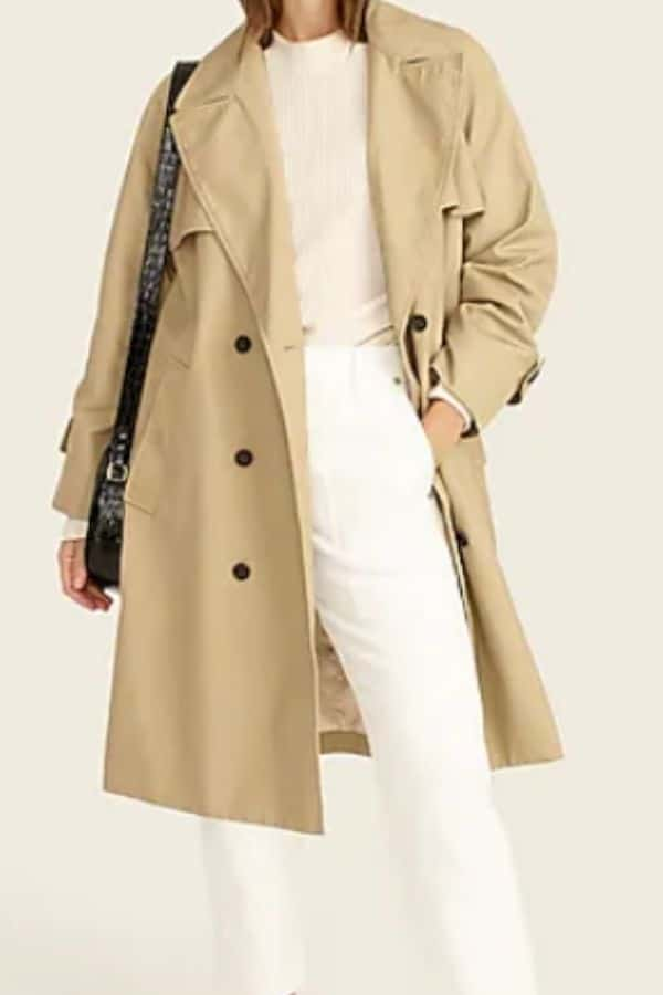 trench coat over ivory and white outfit