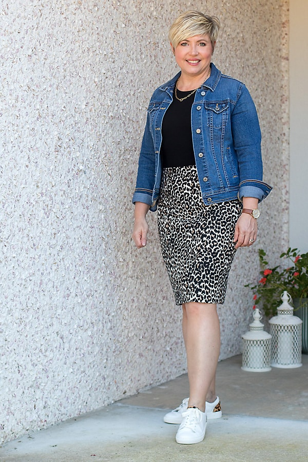 leopard pencil skirt outfit with denim jacket and sneakers